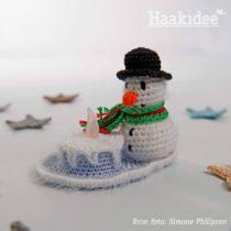 sneeuwpop met lichtje